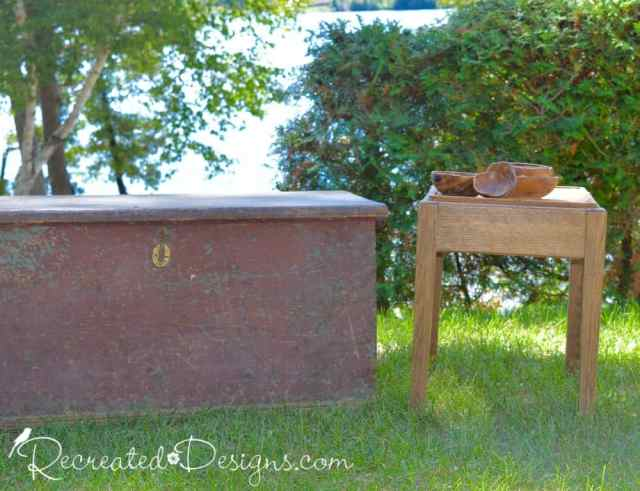 antique trunk and a small side table with wooden bowls