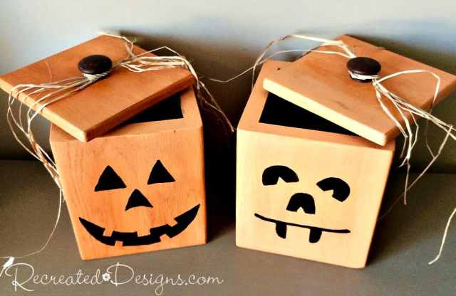 Two vintage wood canisters painted like Jack-O-Lanterns to hold Halloween treats