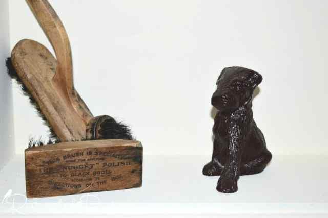 antique shoe shine brushes and cast iron dog