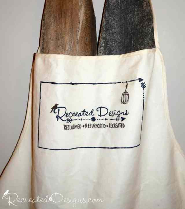 hand painted apron with Recreated Designs logo
