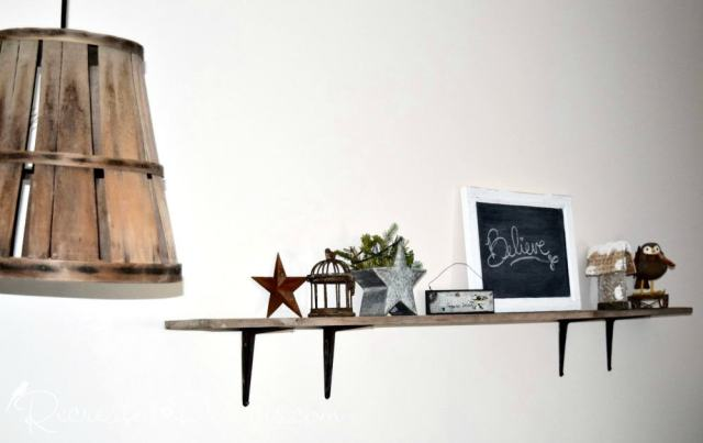 reclaimed wood shelf with holiday decor and wood basket hanging lamp