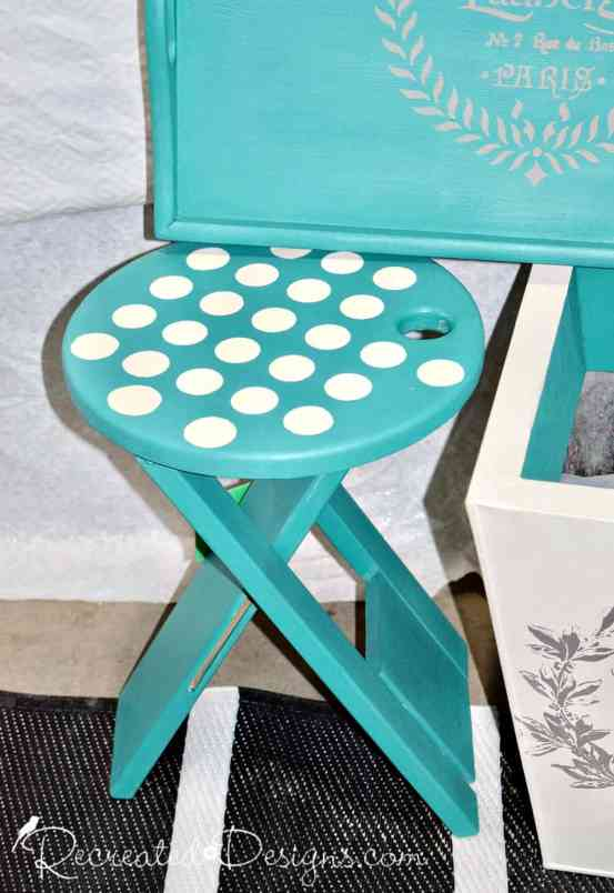 turquoise painted stool with white polka dots