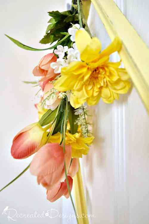 Spring flowers and a frame hanging on a door