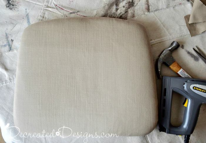 an Art Deco chair seat recovered with new Linen fabric