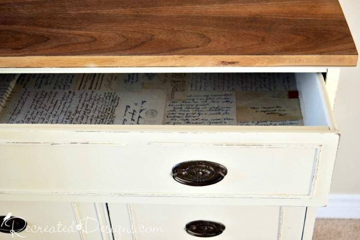 vintage buffet drawer filled with decoupaged old letters and cards