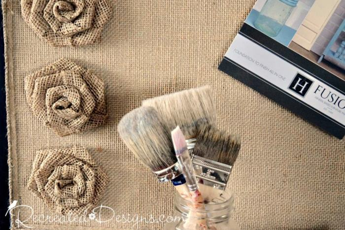 reclaimed cork board covered with burlap and flowers