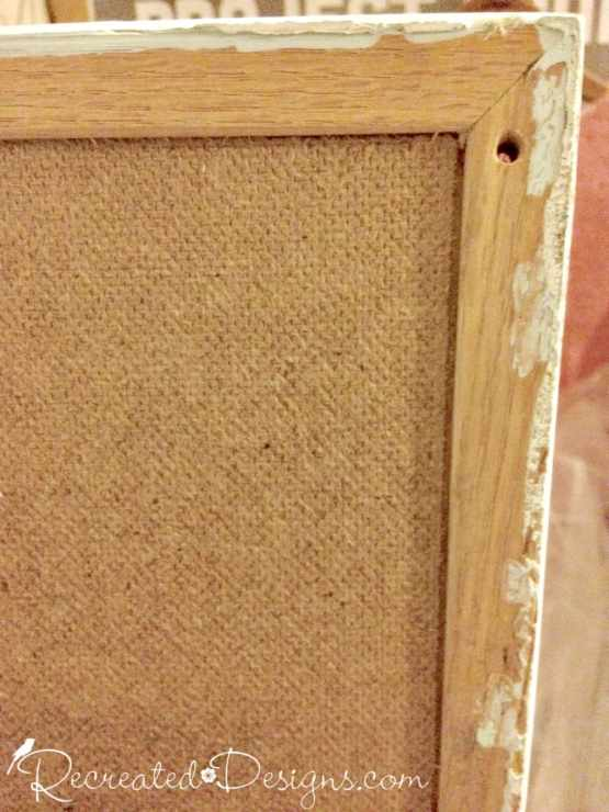 salvaged cork board with holes and paint