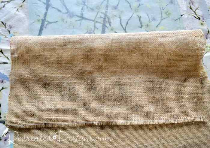 adhering burlap to glass to make the backdrop for a memory board