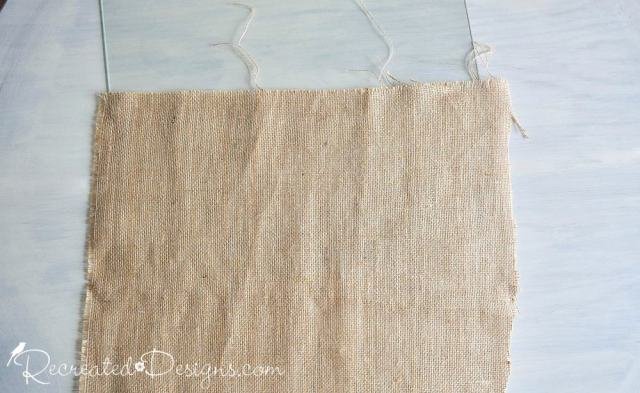 cutting a piece of burlap to make the back of a memory board