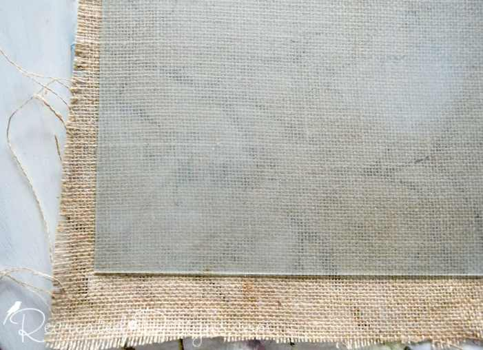 burlap glued to a piece of glass from a salvaged frame