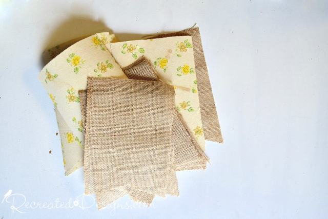 bunting pieces cut from vintage wallpaper and burlap