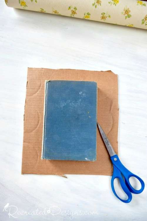 using an old book as a template to cut out bunting