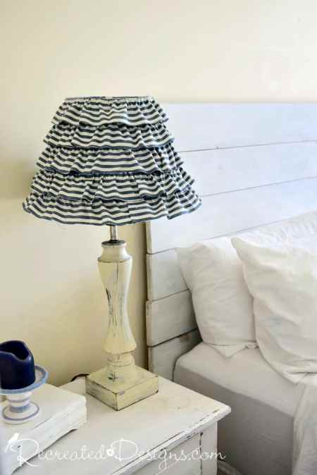 Lamp that was saved from the dump recreated with paint, glue and fabric