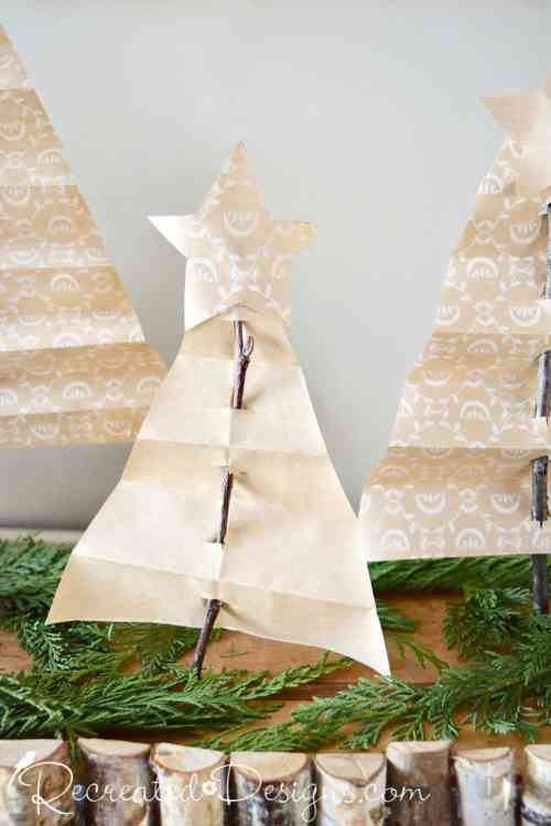 paper Christmas trees on twigs