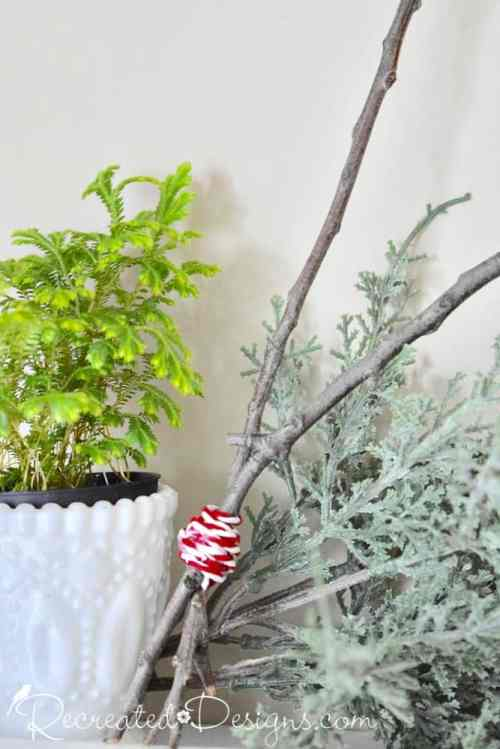 greenery wrapped around twigs with a Christmas fern