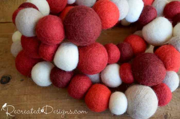 red and white balls of wool made into a garland
