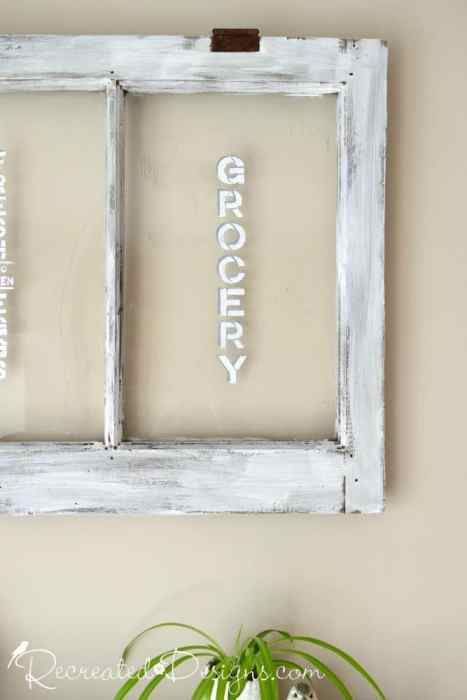 Grocery stencilled onto an old window