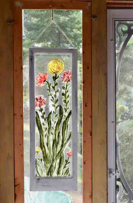 hand painted flowers on a window