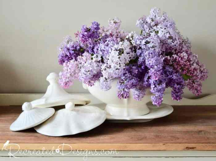 beautiful multicoloured lilacs in a vintage Ironstone tureen with lids