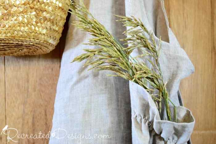 linen apron with straw and straw bag