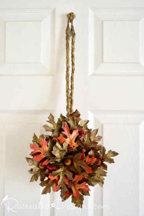a beautiful Fall wreath made from an old picking basket by Recreated Designs
