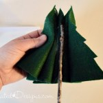 adding real twigs to felt Christmas trees