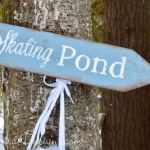 Skating Pond sign hanging on a tree
