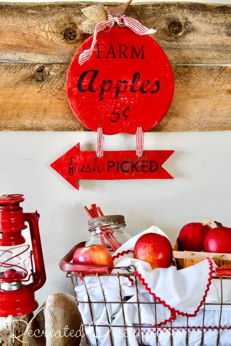 thrifted cutting board turned apple sign for fall
