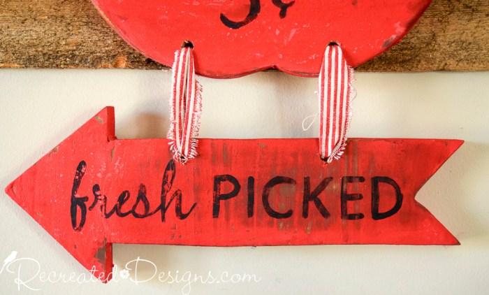 fresh picked apple sign arrow