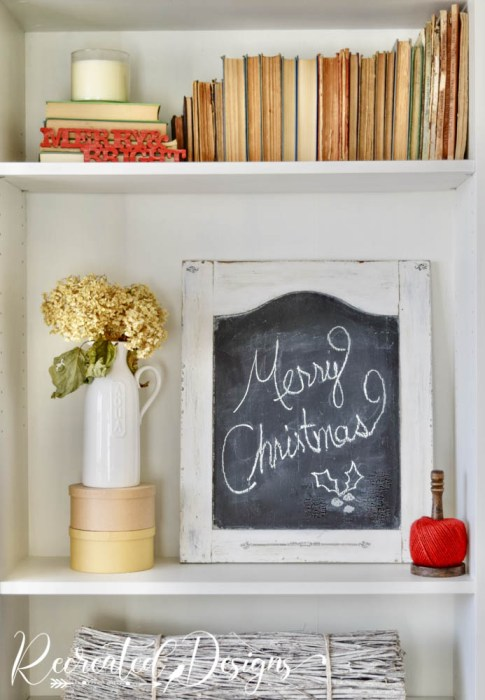 bookshelves decorated for the holidays