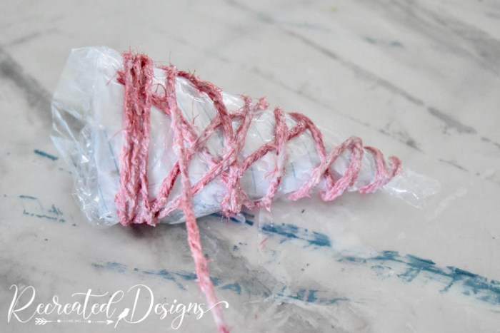 wrapping a cone with string soaked in Mod Podge