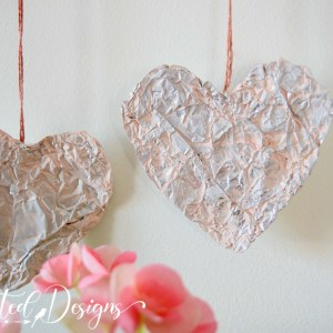 tinfoil hearts painted light pink