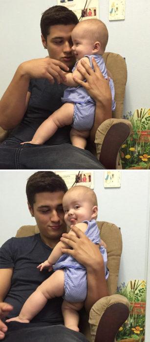 bebé en los brazos de su atractivo padre.