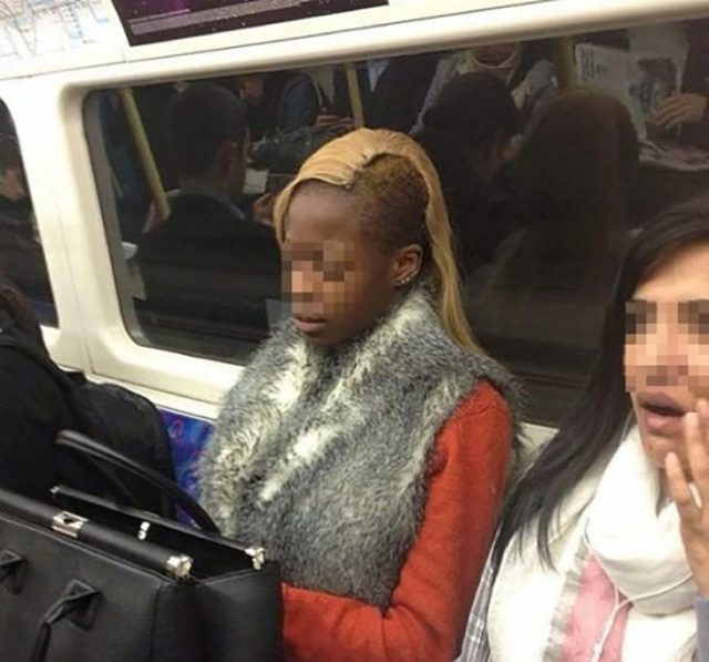 mujer cn el pelo amarillo y un costado rapado