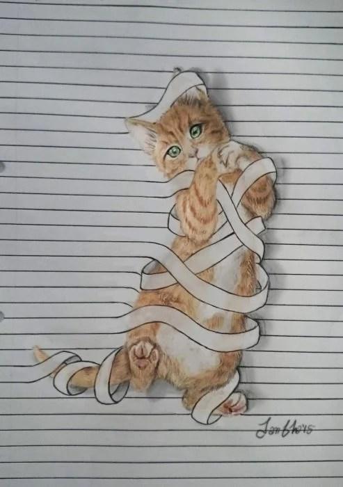 dibujo gatito en libreta