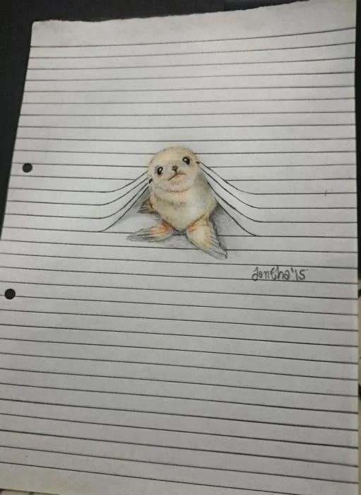 dibujo foca asomada en libreta
