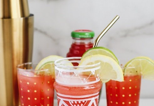 A glass of Spiced Wonder Melon Vodka Punch recipe