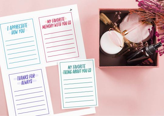 Photo of pick-me-up notes next to a gift bag