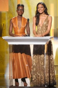 Lupita Nyong'o in Givenchy and Naomie Harris in Valentino