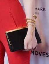 Dakota Fanning 's clutch and Paula Mendoza cuff