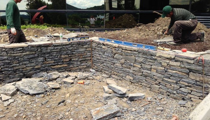 Use A Retaining Wall To Divert Water