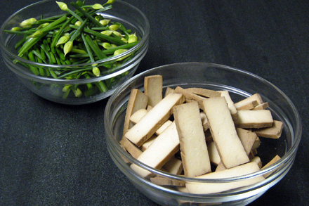 Cut up Chinese chive blossoms and pressed tofu