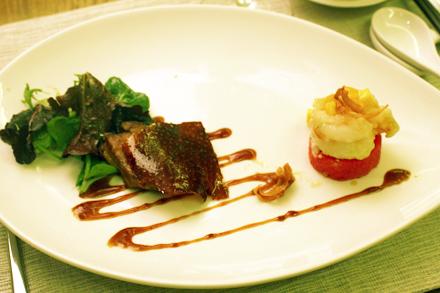 A Duo of Crispy Wasabi Prawn, and Peking Duck Skin over Pan-Seared Foie Gras