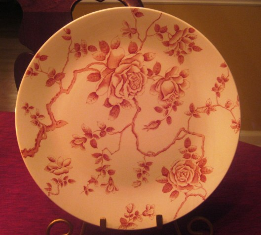 red plate dining room table single plate close up