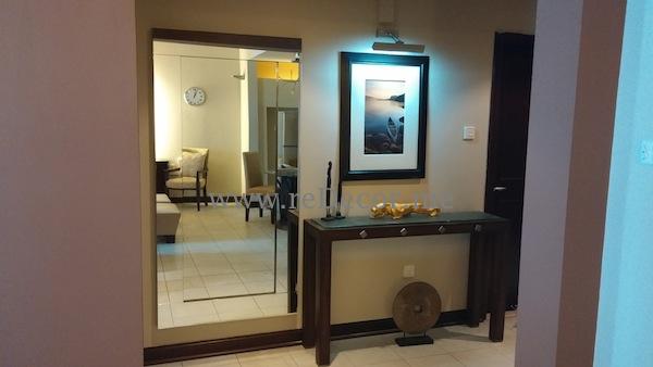 small apartment red and brown decor in Dubai Marina