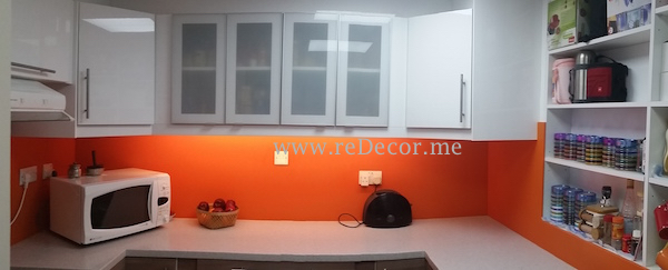 white kitchen with corian orange backsplash and white poppy counter