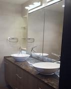 fit out bathrooms dubai, renovation, remodelling, design powder room motorcity, dubai, stone slabs like wood, 3D tiles, mirror light, recycle, master bathroom complete remodelling, big bathroom, walk in shower, 2 basins, mirror