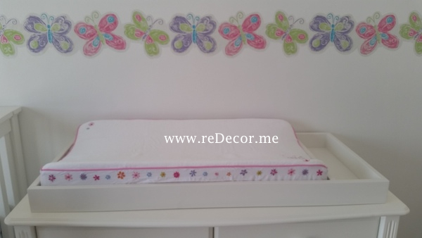 baby girl room with butterflies and flowers, simple white pink lime green interior decor for kids in dubai