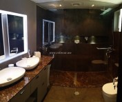 before and after Master bathroom renovation, 2 showers, walk in, marble shower, tops, Interior design by Erika Pace, brown tiles with brown marble, 2 walk in showers, 2 basins, Ceramic Dubai