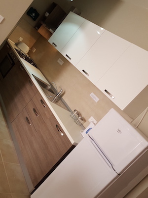 modern kitchen design Malta, fit outs, consultation, decor, white and walnut kitchen with grey tiles